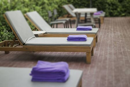 Bench at swimming pool for relaxation Banco de Imagens