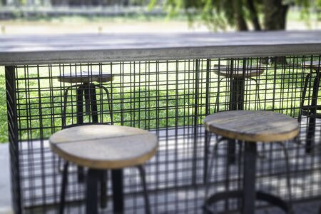 Wooden outdoors seats in summer garden, stock photo Zdjęcie Seryjne
