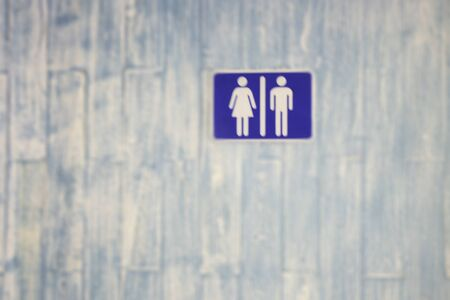 Information board for toilets sign on blue door, stock photo