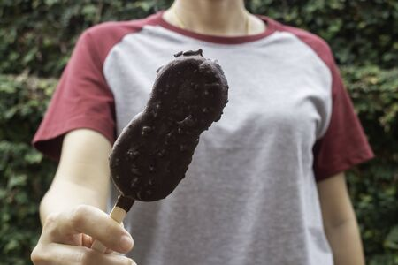 Ice cream covered with chocolate and nuts, stock photo