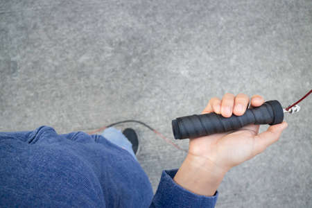 Hand of woman holding a speed jump rope, stock photo Imagens