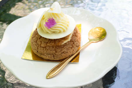Buns choux pastry sprinkled with white chocolate, stock photo