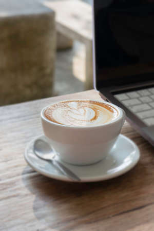 Morning coffee latte on wood desk work from home office Stockfoto