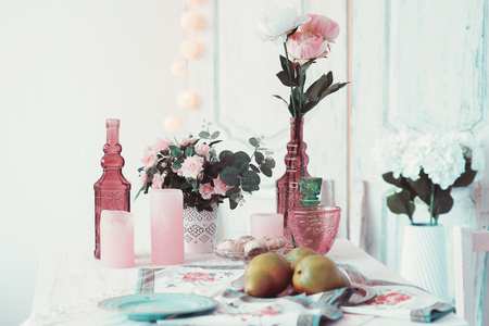 adorned: Beautifully decorated table adorned with flowers and pears