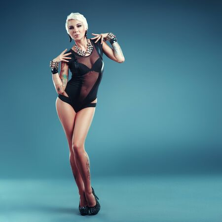 chic panties: Sexy blonde girl with tattoos posing underwear