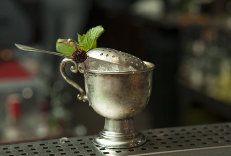 barmen: Johnnie Royal Berry Julep alcohol coctail on the table of bar of whiskey berry pure mint and sugar powder