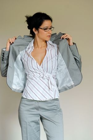 Business Woman Taking off Suit photo