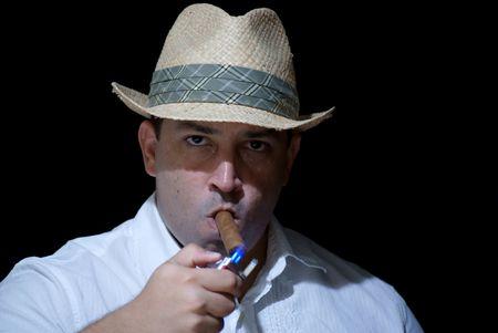 Man Lighting up a Cigar photo