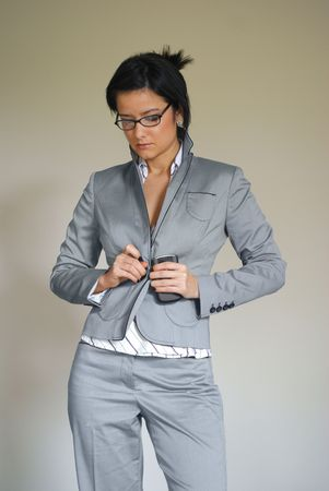 Woman Buttoning or Unbuttoning Suit photo