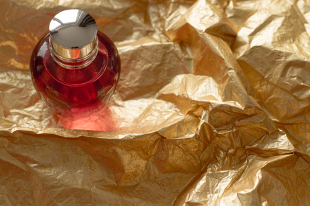 bottle nose: gold paper perfume red bottle