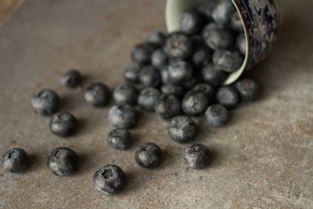 foodies: Fresh and juicy blueberries on a gray background