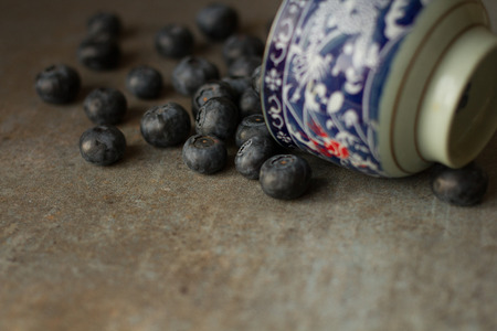 Fresh and juicy blueberries on a gray background photo