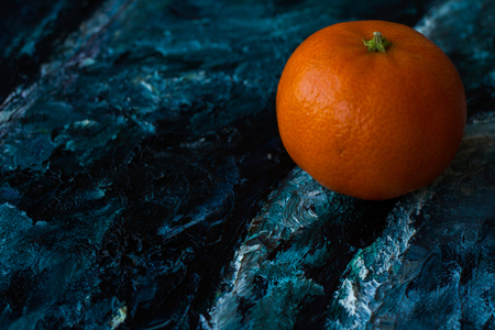 Mandarin orange in the picture. canvas razrisovon blue red photo