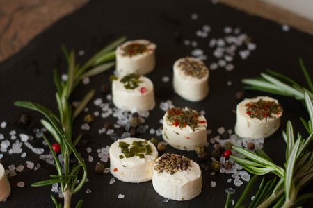 rosemary: soft goat cheese with rosemary on a gray background