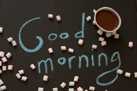 good morning with a cup of cocoa on a wooden background