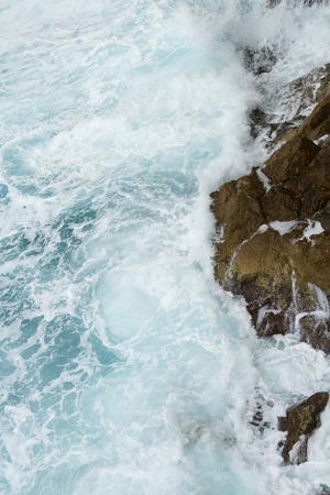 sea wave: beating the rock sea wave. extreme sports