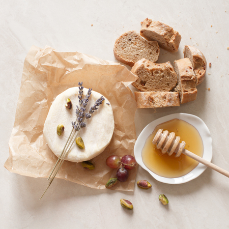 bread: appetizer wine cheese bread and honey Stock Photo