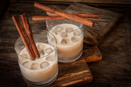 liqueur: Irish cream liqueur in a glass with ice and cinnamon