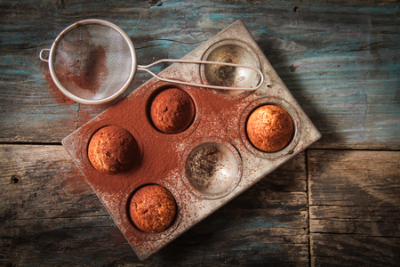 muffin: delicious lemon muffins with tea and coffee romantic mood Stock Photo