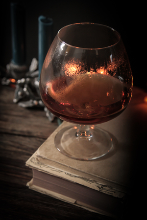 philosophical: glass of whiskey in the dark. Philosophical business evening