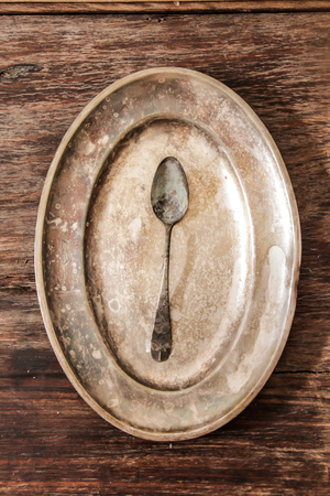 grunge flatware: cutlery for every day and for a celebratory dinner on the wooden background
