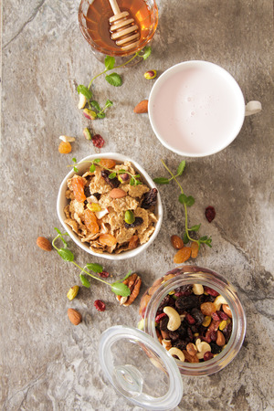 light breakfast: cup of muesli with strawberry milk and honey light breakfast Stock Photo