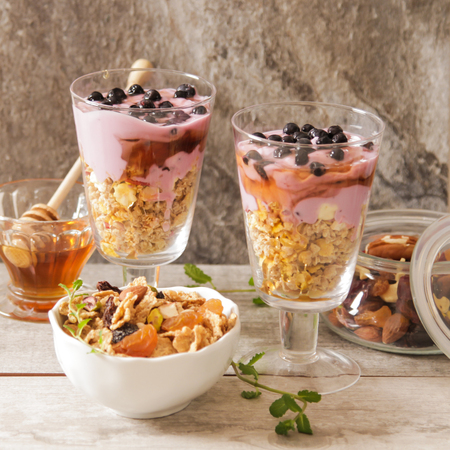 light breakfast: cup of blueberry yogurt with granola and honey light breakfast Stock Photo