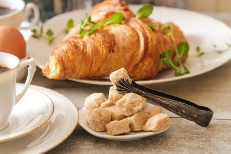 light breakfast: French light breakfast of coffee and croissants with jam honey on a light background Stock Photo