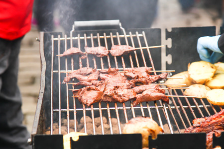 fried food: street food. skewers of meat on a skewer, fast food people