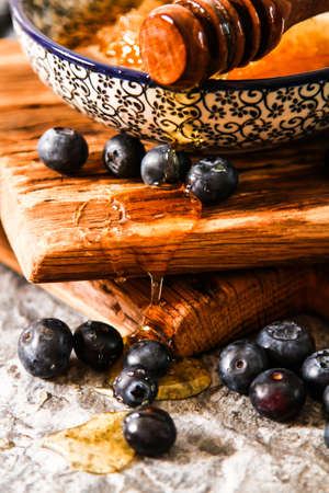honey comb: honey comb and blueberries on a stone background