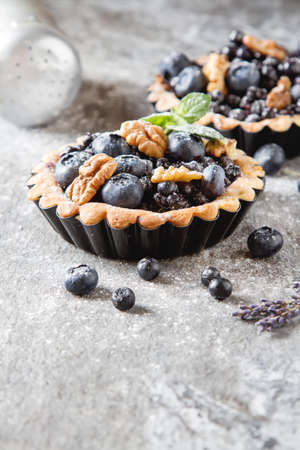 blueberry pie: Homemade blueberry pie with mint. stone table