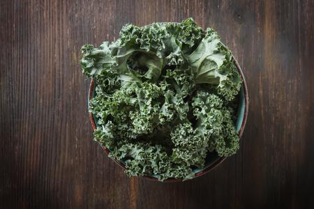 Fresh sliced Italian Kale Salad on a blue plate. Dark background