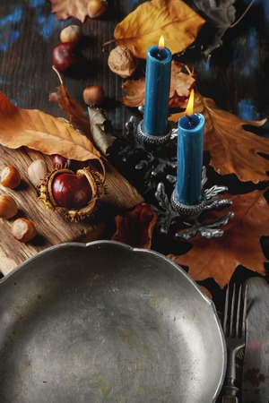 space text: Decorating for Halloween. Autumn card. The gray metal plate, chestnuts, nuts, leaves. free space text Stock Photo