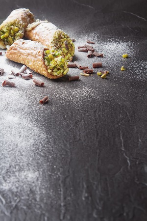 cannoli pastry: Sweet homemade cannoli stuffed with ricotta cheese cream and pistachial Sicilian dessert. Italian pastry.