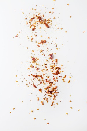 Red hot chili peppers flakes. White background. isolated