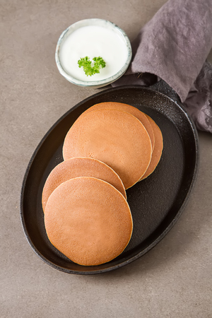 the view option: Breakfast option. American pancakes. Country style. Dark background. Top view. Copy space. Selective focus. The concept of a healthy diet or dietary nutrition