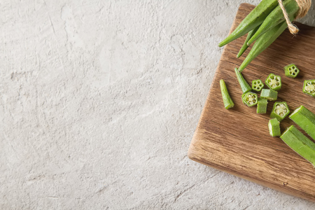 Lady Fingers or Okra over concrete table background. Space for text