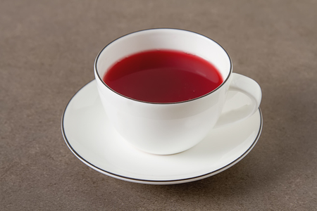 Original red tea hibiscus in a white karemic cup. Net food, weight loss, the concept of vegetarian food. Copy space