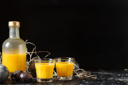 Traditional Italian yellow egg liquor, Bombardino. Dark background. Copy space Stock Photo