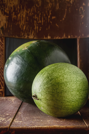 Watermelon whole. Dark wood background. Autumn photos Stock Photo