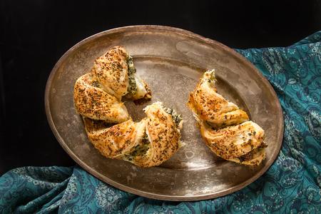 Greek pie spanakopita with spinach, cheese. Simple dark background. Healthy food. Lifestyle