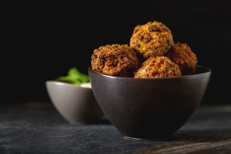 Middle Eastern traditional dishes. Falafel with sour cream. Vegetarian food Standard-Bild