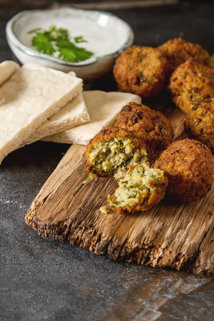 Middle Eastern traditional dishes. Falafel with sour cream. Vegetarian food Stock Photo