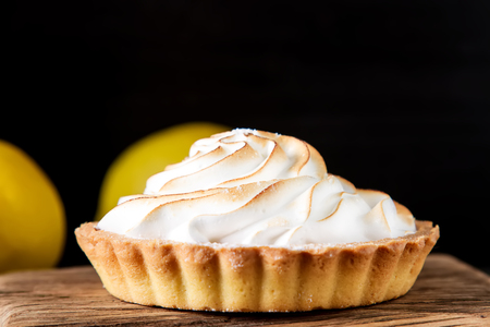 French dessert. Tartlet with lemon. Dark background