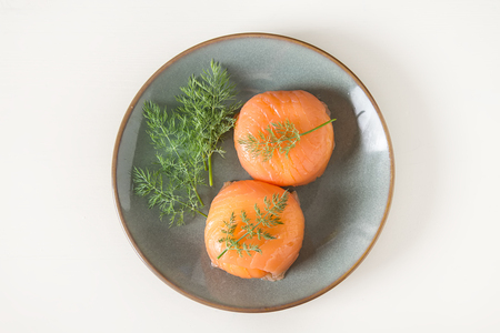 caper: Smoked salmon, mousse, pate with dill and lemon. Light white background. Italian food