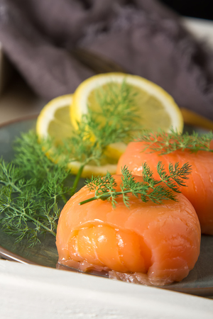 caper: Smoked salmon, mousse, pate with dill and lemon. Dark background. Italian food