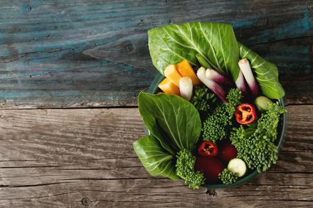 Italian green salad. Broccoli, peppers, tomatoes, onions, bochkoi. Dietary food. Dark background Stock Photo