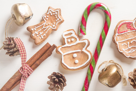 gingerbread man: Merry christmas holiday decoration background with ginger man snowflakes snowman and tree cookies dry orange. Light wooden table. Space for text