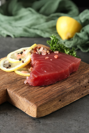 Steak of tuna for grilling. Dark background. Seafood Stock Photo