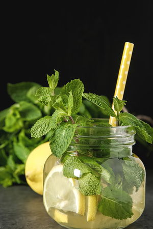 Fresh mint leaves in tea. Italian herbs. Dark background Stock Photo